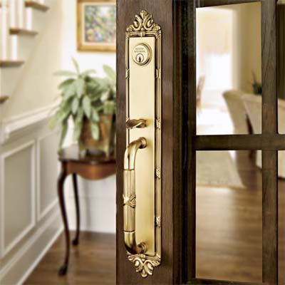 forged brass entry set inset on wood and glass interior door