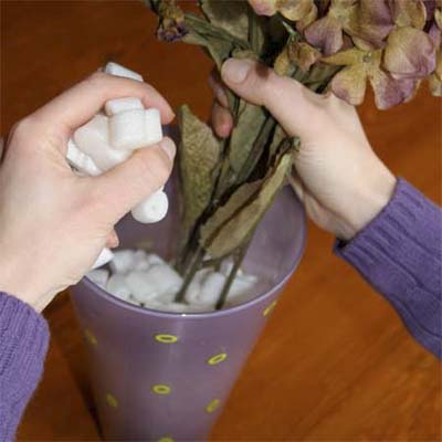 use a packing peanuts to fill the bottom of a deep vase