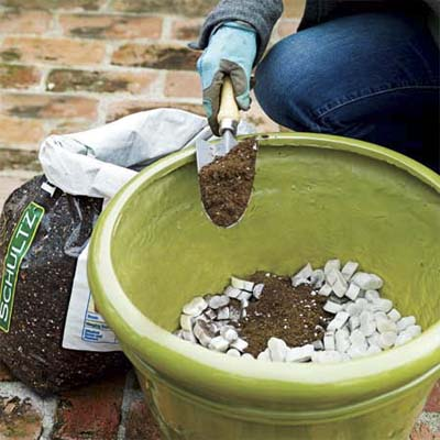 use packing peanuts to boost drainage in and lighten large planting pots