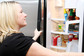 woman looking in the refrigerator