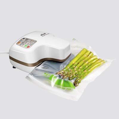 vacuum sealer sealing asparagus