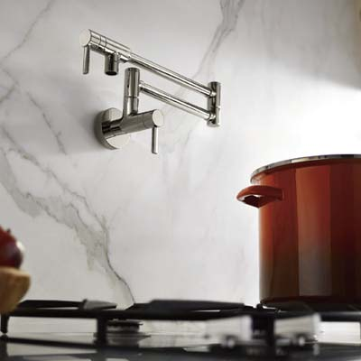 pot filler faucet attached to marble wall above stove
