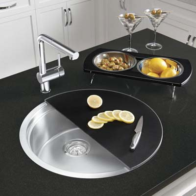 round sink with half-moon cutting board and tray with bowls
