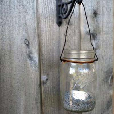 glass mason jar with tea light used as lantern