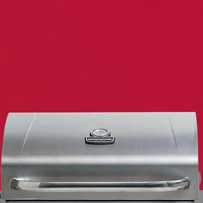 the Char-Broil Commercial Series four-burner propane grill close up on the lid