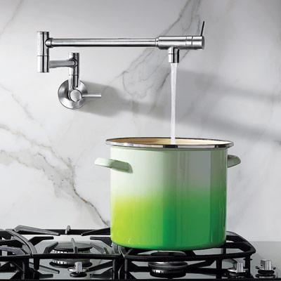 moen's modern show house pot filler filling up large pot on stove top