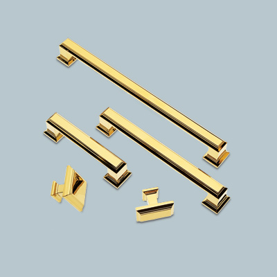 assortment of polished gold pulls and knobs from sutton place spa collection