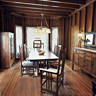 dining room with recessed woodwork panel walls of this victorian and craftsman style cottage