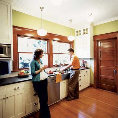 homeowners in remodeled kitchen of this victorian and craftsman style cottage
