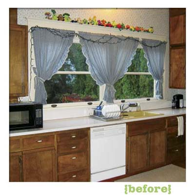 kitchen of this victorian and craftsman style cottage showing the existing cabinets before remodel