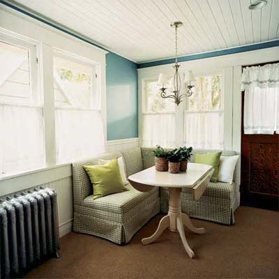 remodeled exposed porch of this victorian and craftsman style cottage