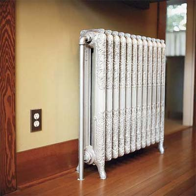 one of the salvaged radiators installed in this victorian and craftsman style cottage