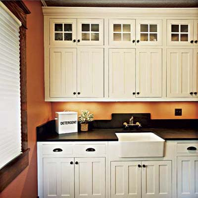 combined laundry and pantry of this victorian and craftsman style cottage after remodel