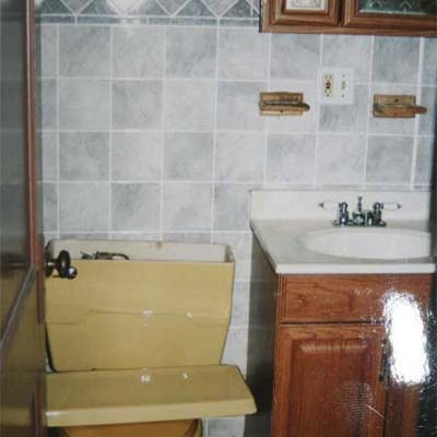 outdated bathroom with yellow toilet