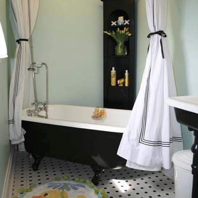 chic bathroom with black claw foot tub