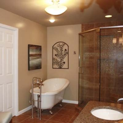 updated bathroom with shower and claw foot tub