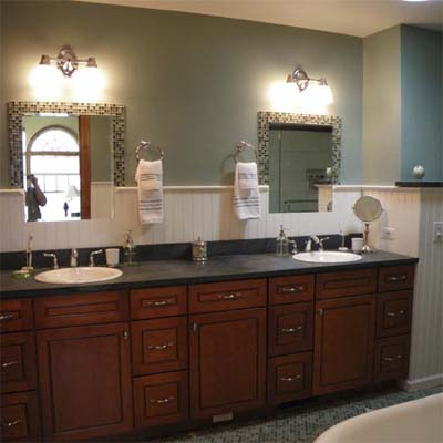 remodeled bathroom with double wood sink vanity