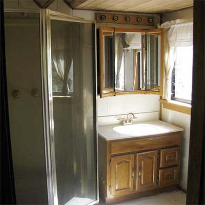outdated bathroom with stall shower