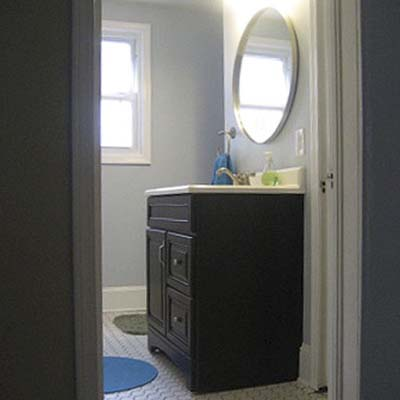 updated freestanding bathroom vanity with mirror