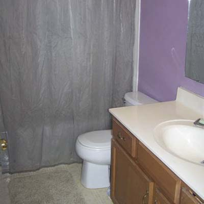 outdated bathroom with purple walls