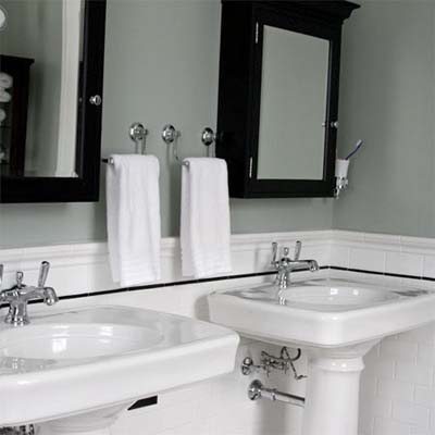 remodeled bathroom with two pedestal sinks