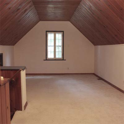 attic with sloped ceilings
