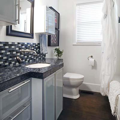 remodeled bathroom with tiled backsplash