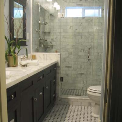 remodeled bathroom with tiled backsplash