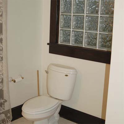 unfinished bathroom with glass tile window
