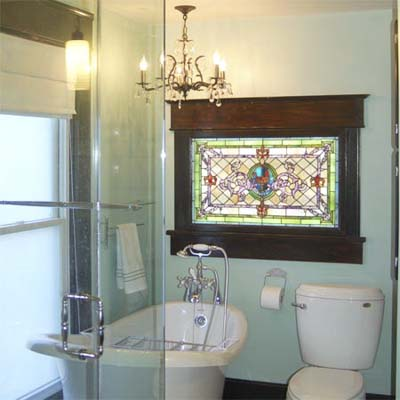 remodeled bathroom with stained glass window and chandelier