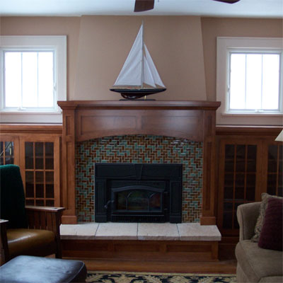 living room with brick fireplace and leather chair
