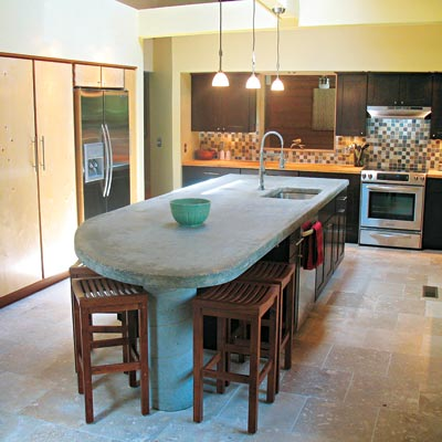 remodeled kitchen with concrete countertop