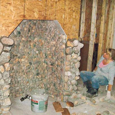 woman building stone hearth