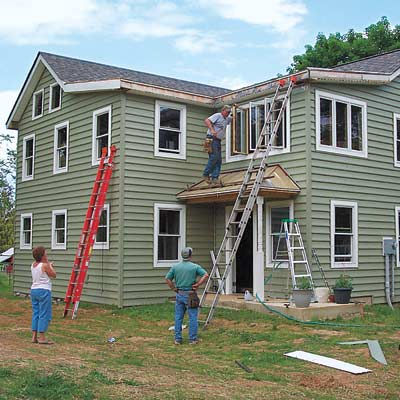 men working on exterior of house