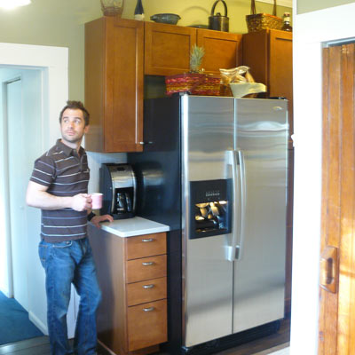 man standing in remodeled kitchen