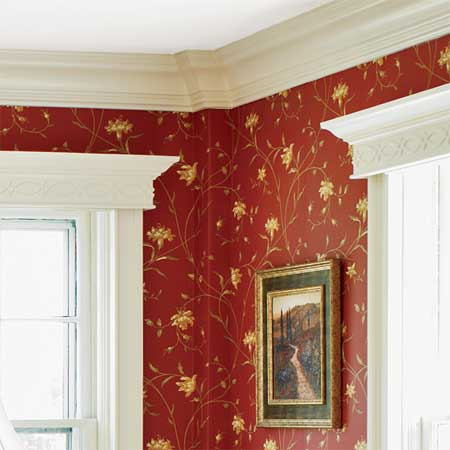 crown molding and vintage wallpaper grace the master suite in this remodeled greek revival