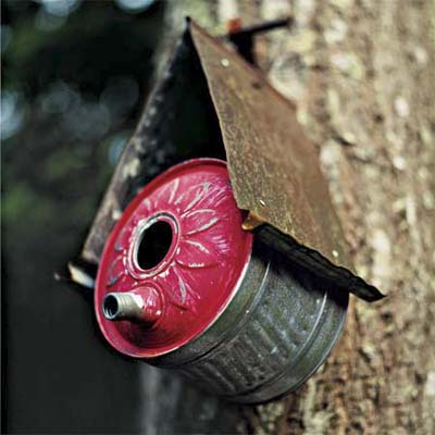 handmade birdhouse made of an old oilcan
