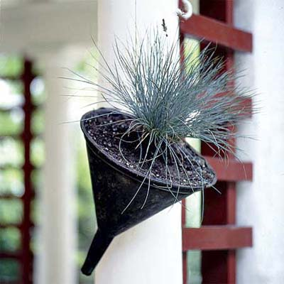 an old funnel converted into a hanging planter