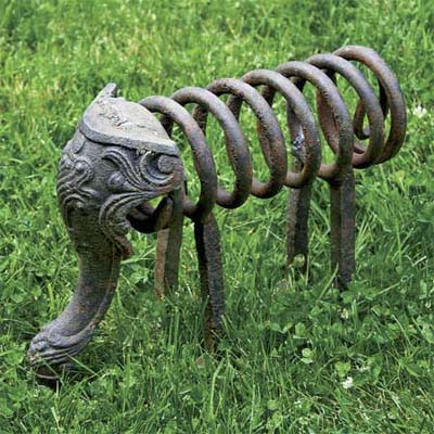 an ornamental sculpture of an elephant made from an old spring and a claw foot from a cast iron tub