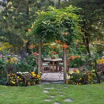 antique elements border a garden patio