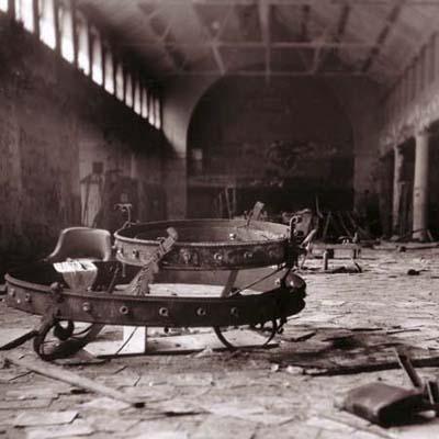 fallen chandelier in asylum cafeteria ruins