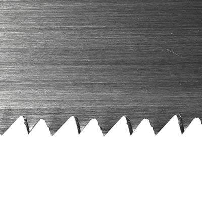 close up of teeth of a crosscut saw
