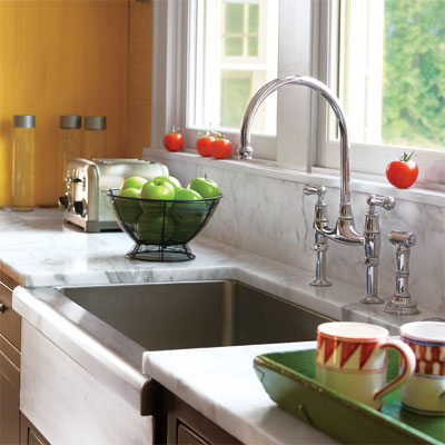 traditional bridge kitchen faucet with white marble counters