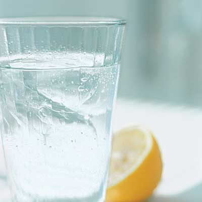 glass of water and half a lemon