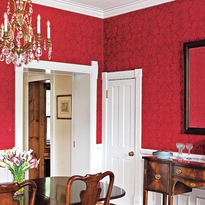 Red Majestic Damask nonwoven wallpaper in a dining room