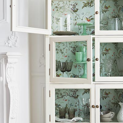 Tropical Birds vinyl-coated wallpaper inside a glass-front cabinet