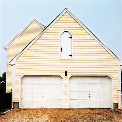 house with unattractive garage doors