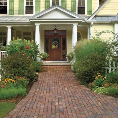 manicured house with welcoming walk