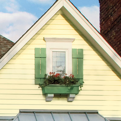 house with curb appeal and flower boxes