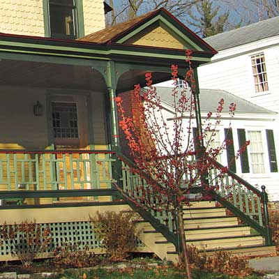 repainted stick style house with curb appeal and welcoming entry